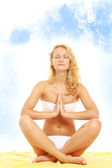 Woman in a swimsuit meditating — Stock Photo