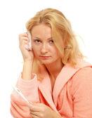 Jonge vrouw met een hoofdpijn — Stockfoto