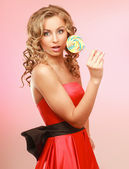 Young happy woman with lollipop. — Stock Photo