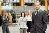 Businessmen standing with his staff — Stock fotografie