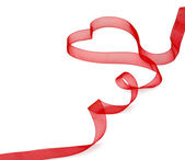 A red ribbon shaping heart — Foto de Stock