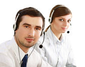 Oung people working in a call center — Stock Photo