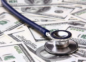 Heap of dollars with stethoscope. — Stock Photo