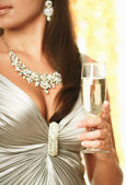 Brunette woman drinking champagne — Stock Photo
