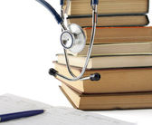 Medical education with book and stethoscope. — Stock Photo