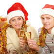 People in santa hat drinking champagne — Stock Photo
