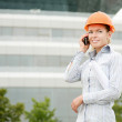 Woman architects with mobile phone — Stock Photo