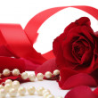 Pearl beads and red roses petals — Stock Photo #45346649