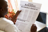 African American businessman reading a newspaper — Stock Photo