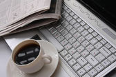 Coffee cup,newspaper and laptop — Stock Photo