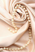 Silk and pearl — Stock Photo