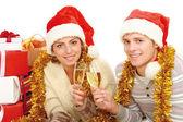 People in santa hat drinking champagne — Stock fotografie