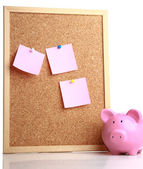 Board of stickers and piggy box — Stock Photo