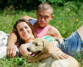 Couple With Their Puppy. — Stock Photo