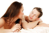 Heterosexual couple on the bed. — Stock Photo