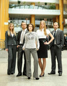 Businessmen standing with his staff — Stock Photo