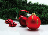 Decoration balls and fir branch — Stock Photo