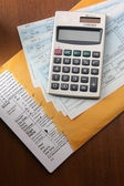 Calculator on business paper. — Stock Photo