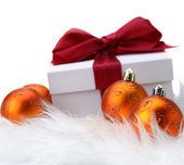 Christmas balls and gift. — Stock Photo