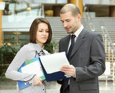 Businespeople  with businessplan — Stock Photo