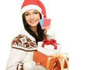 A young woman with a Christmas present and cards, isolated on white. — Stockfoto
