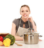 Woman in apron and food — Stock Photo