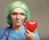 Female doctor holding heart — Stock Photo