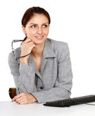 Businesswoman sitting on the desk — Stock Photo