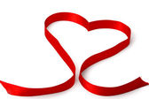 Red ribbon shaping heart — Stock Photo