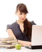 Woman with laptop and books. — Stock Photo