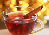Hot christmas drink with cinnamon sticks — Stock Photo