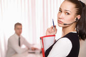 Businesswoman standing in office — Stock Photo