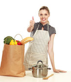 Woman  with grocery bag and showing ok — Stock Photo
