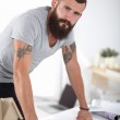 Portrait of male architect with blueprints at desk in office — Stock Photo #51140701