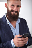 Close up of a man using mobile smart phone, isolated on white background — Stock Photo