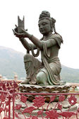 Buddhist Deva statue — Stock Photo