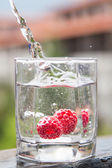 Raspberry falls under water — Stock Photo