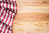 Tablecloth textile on wooden background — Stock Photo