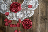 Handmade flowers on wooden background with old white vintage lace — Stock Photo