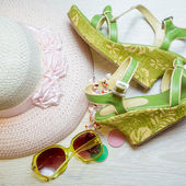 Summer vacation concept with sandals, hat and sunglasses — Stock Photo