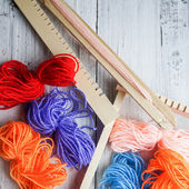 Colorful threads and loom — Stock Photo