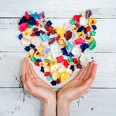 Flower heart and woman hands — Foto Stock