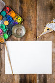 Blank paper brush and paints — Stock Photo