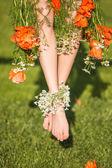 Female feet with flowers — Stok fotoğraf