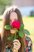 Sad woman with flower — Stock Photo