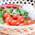 Tomatoes, garlic, chili pepper and greens — Stock Photo #41909563