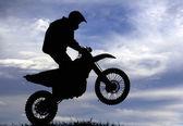 Motocross racer silhouette — Stock Photo