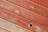 Pine wood panelling painted red — Stock Photo