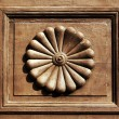 Stock Photo: Ornamental inset of old wooden door
