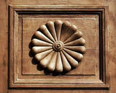 Ornamental inset of an old wooden door — Stock Photo